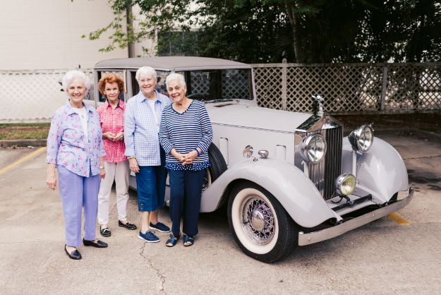 Jo, margarette, yvonne and katherine at a car show