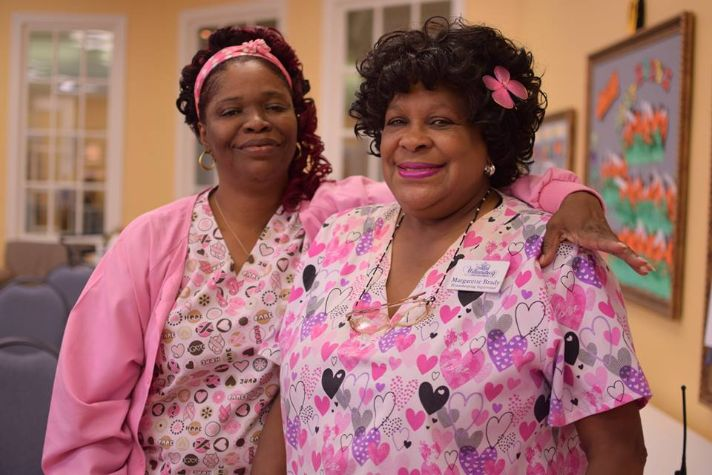 Margarette and Alesha in the tiger room for breast cancer awarmess