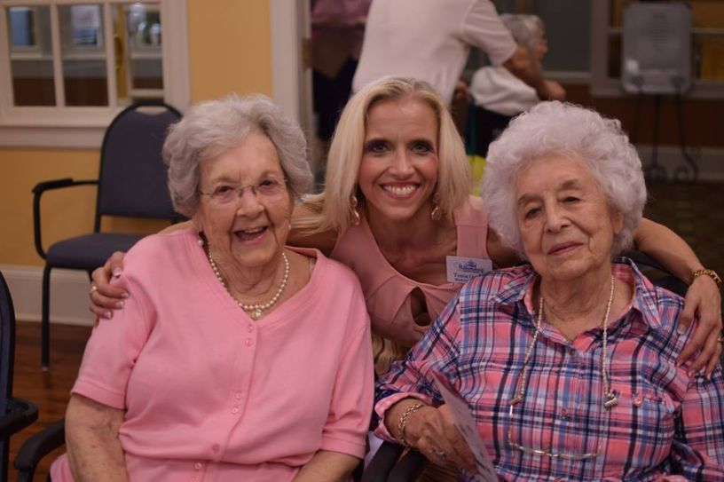 Tonia smiling with residents