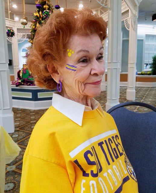 margarette getting her face painted for lsu tailgate party